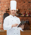happy male chef cook holding tablet pc - PhotoDune Item for Sale