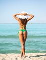 young woman sunbathing on beach - PhotoDune Item for Sale