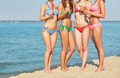 close up of young women with ice cream on beach - PhotoDune Item for Sale