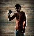 young man with dumbbell flexing biceps - PhotoDune Item for Sale