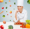 smiling female chef with vegetables - PhotoDune Item for Sale