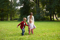 happy family playing together outdoor in park - PhotoDune Item for Sale