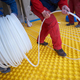 workers installing underfloor heating system - PhotoDune Item for Sale