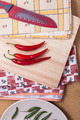 Chili peppers and knife on chopping board - PhotoDune Item for Sale