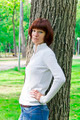 Woman with brown hair near tree - PhotoDune Item for Sale