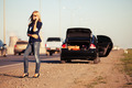 Fashion woman next to broken car calling on cell phone - PhotoDune Item for Sale