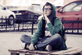 Fashion teen boy sitting on a city sidewalk - PhotoDune Item for Sale