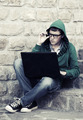 Young man with laptop sitting on the steps - PhotoDune Item for Sale