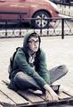 Sad teen boy sitting on a city sidewalk - PhotoDune Item for Sale