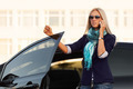 Fashion business woman calling on the phone by her car - PhotoDune Item for Sale