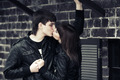 Happy young fashion couple kissing at the wall - PhotoDune Item for Sale