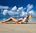Woman in bikini lying on beach at Seychelles - PhotoDune Item for Sale