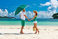 Couple in green on a beach at Seychelles - PhotoDune Item for Sale