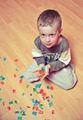 Little boy playing with plastic alphabet on the floor. - PhotoDune Item for Sale