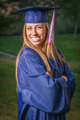 Smiling Young Woman Wearing Cap and Gown Outdoors. - PhotoDune Item for Sale