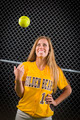 Young Female Softball Player Portrait with Ball in the Air. - PhotoDune Item for Sale