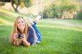 Smiling Young Woman Using Cell Phone Outdoors at the Park. - PhotoDune Item for Sale