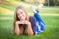 Portrait of a Beautiful Young Woman Laying in the Grass Outdoors at the Park. - PhotoDune Item for Sale