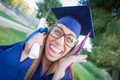 Excited and Expressive Young Woman Holding Diploma in Cap and Gown Outdoors. - PhotoDune Item for Sale