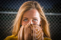 Dramatic Young Woman with Softball Glove Covering Her Face Outdoors. - PhotoDune Item for Sale