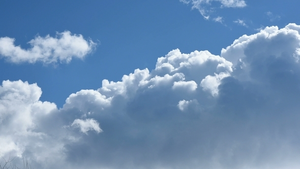 Moving White Clouds in Blue Sky