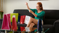 Latina Girl With Shopping Bags Tries Necklace On Sofa - PhotoDune Item for Sale