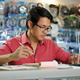 Chinese Man In Computer Shop Checking Bills And Invoices - PhotoDune Item for Sale
