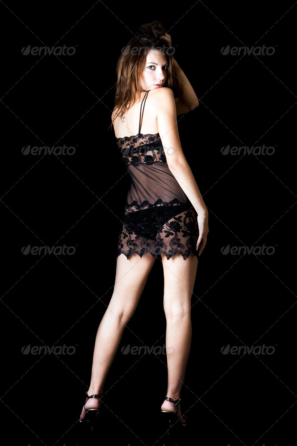 The sexy young beauty woman. Isolated on black - Stock Photo - Images