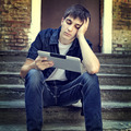 Sad Teenager with Tablet - PhotoDune Item for Sale