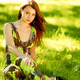Woman sitting in a green field - PhotoDune Item for Sale