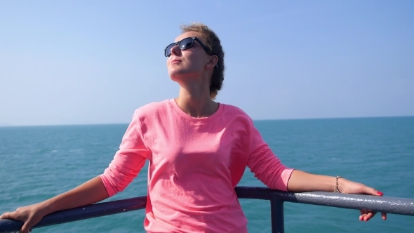 Attractive Girl Enjoying Sunny Day On Yacht Deck
