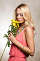 pretty blond girl smelling flowers - PhotoDune Item for Sale