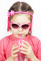 Little cute girl with pink sunglasses drinking water with a pipe - PhotoDune Item for Sale