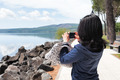 Woman Taking Photos Of Lake With Smartphone - PhotoDune Item for Sale