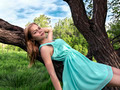 Young sensual blonde girl lying on a tree branch - PhotoDune Item for Sale