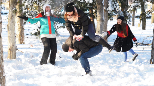 Young People Playing in Wintertime