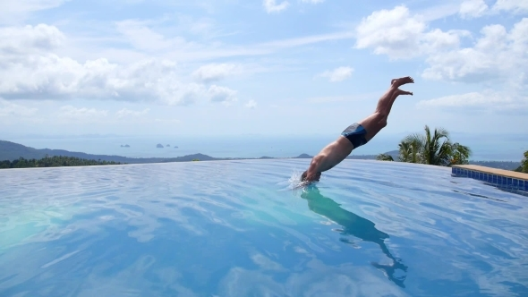 Young Man Jumping In Endless Pool Outdoors Slow