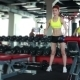 Slender Girl Training With Dumbbells In Gym - VideoHive Item for Sale