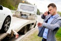 Man calling while tow truck picking up his broken car - PhotoDune Item for Sale