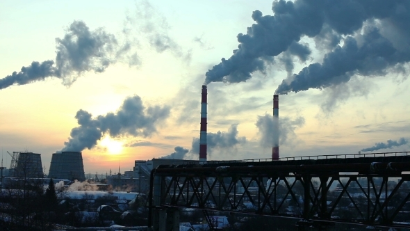 Industrial Winter View At Sunset With Smoke