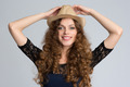 Beautiful young woman wearing hat and smiling at camera - PhotoDune Item for Sale