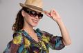 tylish woman wearing hat and sunglasses - PhotoDune Item for Sale