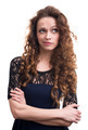 Woman with beauty long curly hair thinking - PhotoDune Item for Sale