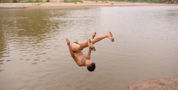 Asian Boy Front Flip Into River
