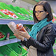 The Girl At The Store Chooses Tomatoes - VideoHive Item for Sale