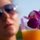 Female In Sunglasses Drinking Fresh Fruit Juice On - VideoHive Item for Sale