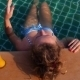 Young Woman In The Swimming Pool With Mango Juice - VideoHive Item for Sale