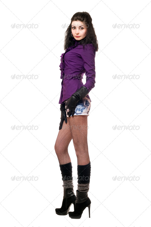 Beautiful young woman in a denim skirt - Stock Photo - Images
