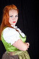 Red hair girl in pin-up style with a bavarian german dress studi - PhotoDune Item for Sale