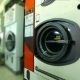 Worker Checks Washing Machines In Laundry Room - VideoHive Item for Sale
